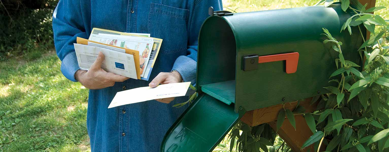 An image of a person getting the mail.
