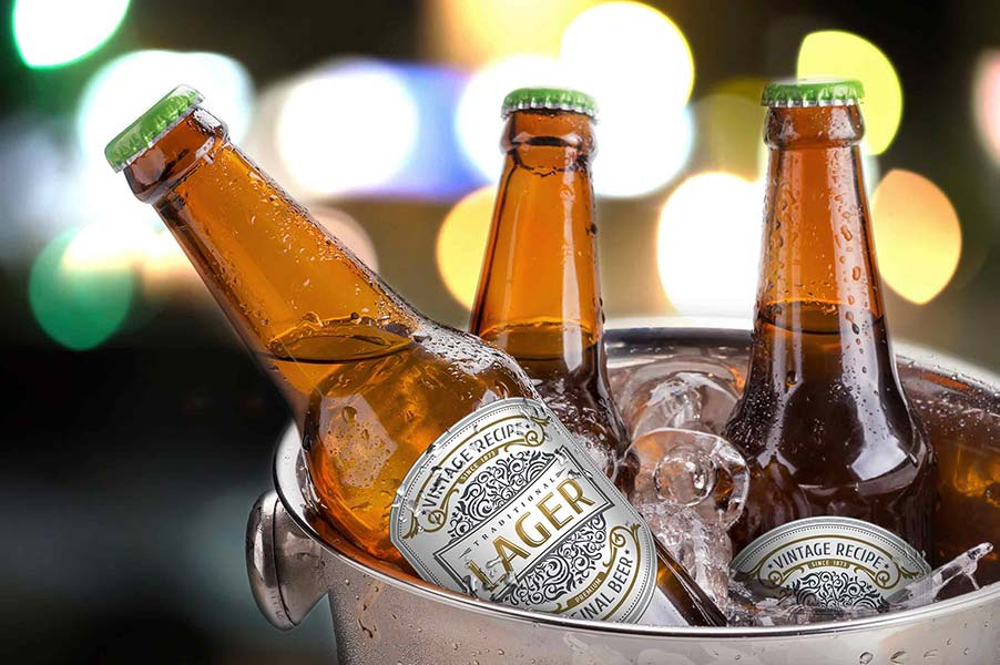 An image of beer bottles in a bucket of ice.