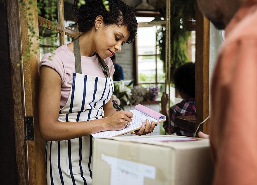 woman writing receipt
