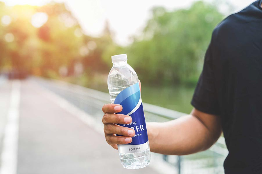 An image of a person holding a water bottle.