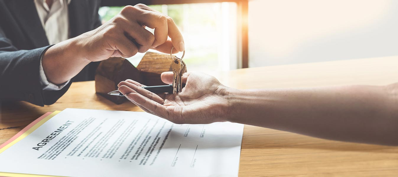 An image of someone handing over house keys.
