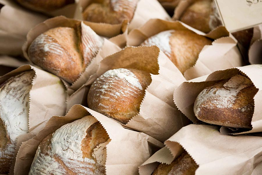 An image of bags of stacked bread.