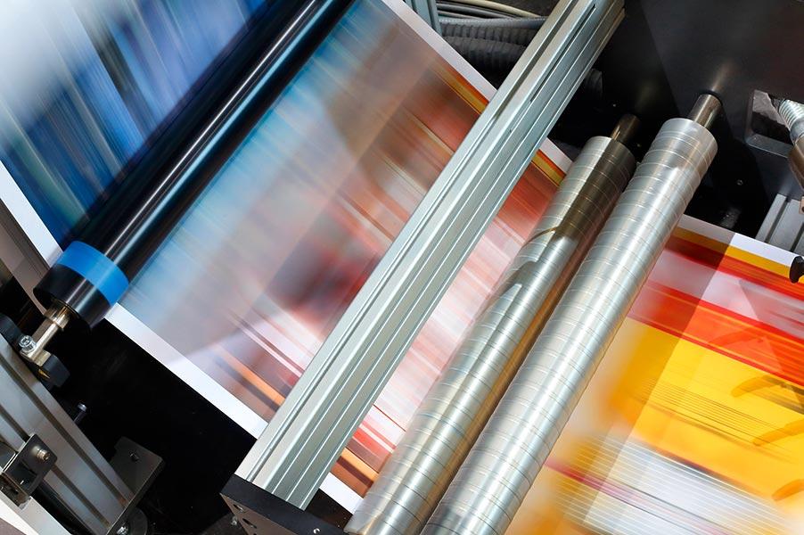 printed inkjet papers running through a high speed printer