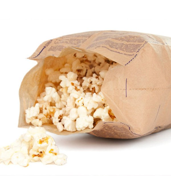 An open bag of microwaveable popcorn