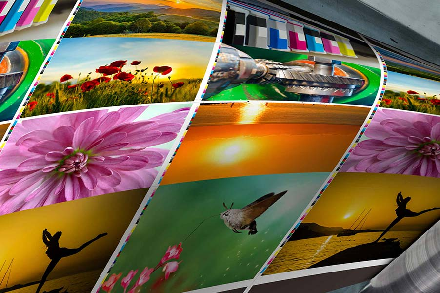 Printed paper with bright images coming out of printer
