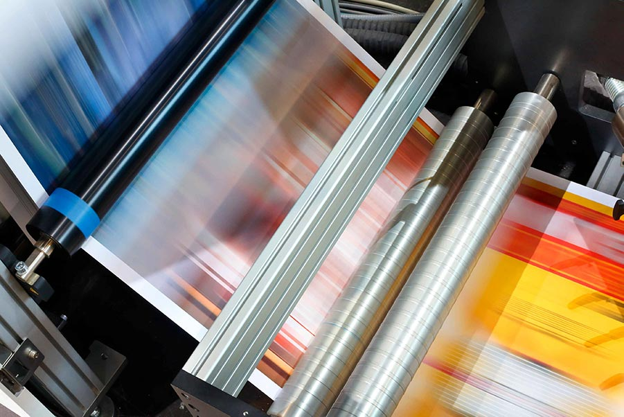 Printed papers running through a high-speed press.