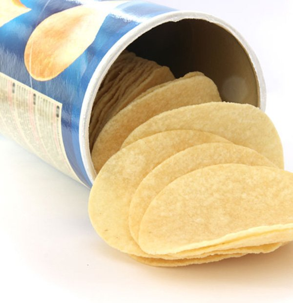 Potato chips spilling out of a canister
